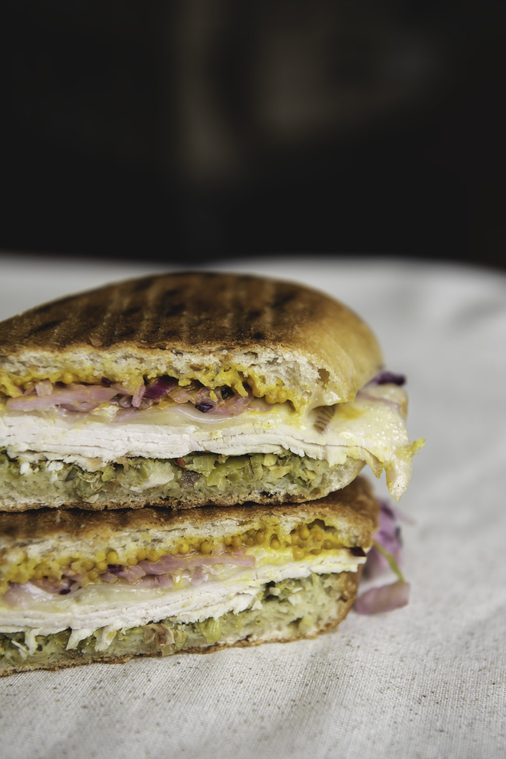 Turkey Cubano Style - Turkey, Adirondack cheddar, pickled mustard seed sauce, coleslaw, pickled relish, on pressed organic ciabatta