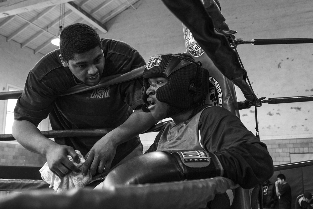 A Becoming a Man: Sport Edition mentor, prepares one of his program members for his first boxing bout. Becoming a Man: Sports Edition pairs mentors with students from Chicago area schools, providing character development curriculum through the medium of after school sports programs.
