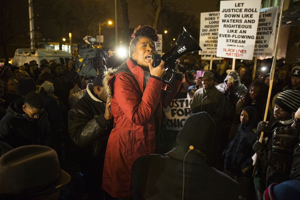 Michelle Dodson, Associate Pastor of New Community Covenant Church, leads hundreds of demonstrators in a prayer of lament. Protestors gathered outside of the Chicago Police Department's main office (3510 S Michigan Avenue)to call for a federal investigation into the death of Laquan McDonald, a Chicago teen gunned down by police.