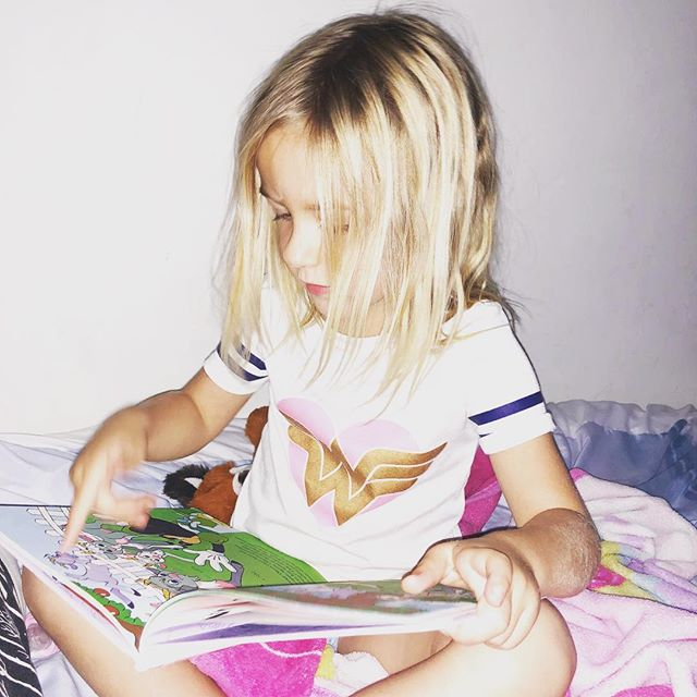 Her love for reading blows my mind.💫 #mindfulmotherhood #wonderwoman #letthembelittle #momlife #toddlerlife #joieleilani