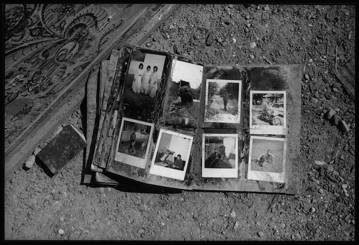 A family photo album found outside a home in thee village of Velika Krusha, Kosovo. Serb forces routinely destroyed family mementos and other indicators of identity and belonging.