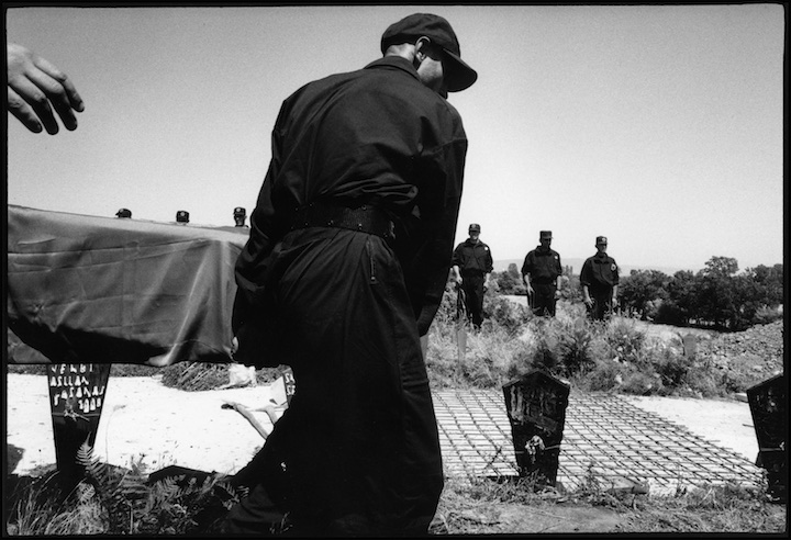 KLA soldiers bury their dead under reinforced concrete because Serb military had recently exhumed bodies of their colleagues.