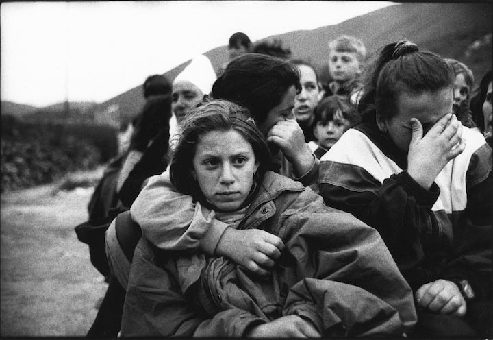 Kosovar refuges who had just crossed the border into Albania having witnessed the murder of their menfolk a few hours earlier in the village of Meja.