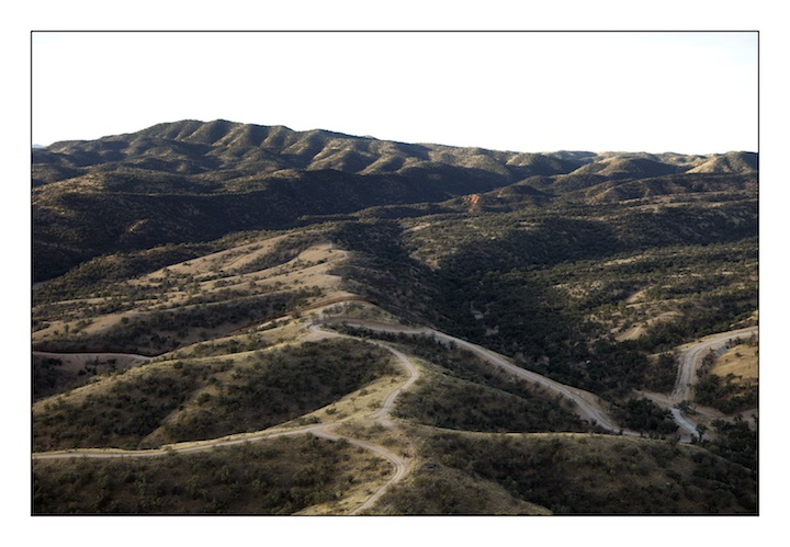 The border fence between Mexico (above) and the United States (below) snakes it's way through the desert scrub east of Nogales in the Pajarita Mountains in Southern Arizona.