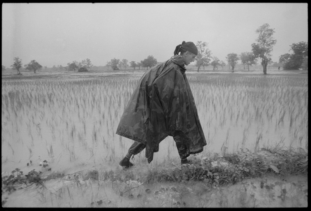 Philip on patrol with the KPNLF during the rainy season in Cambodia. 1990