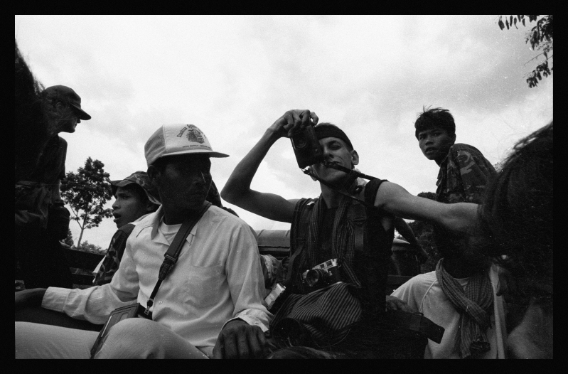 Philip photographing the KPNLF on a short mission in Cambodia. 1990