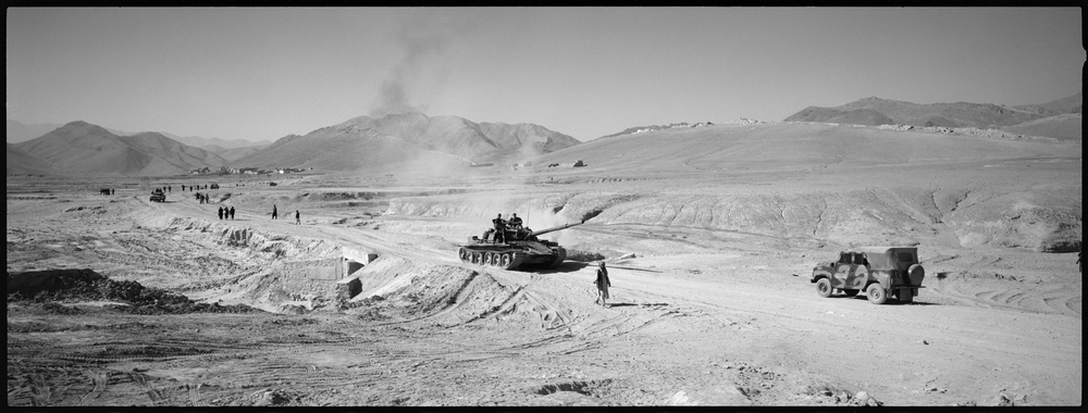Northern Alliance soldiers and T54 tanks retreat from heavy fighting against Taliban forces at Maidan Shah, south of Kabul, in Wardak provice