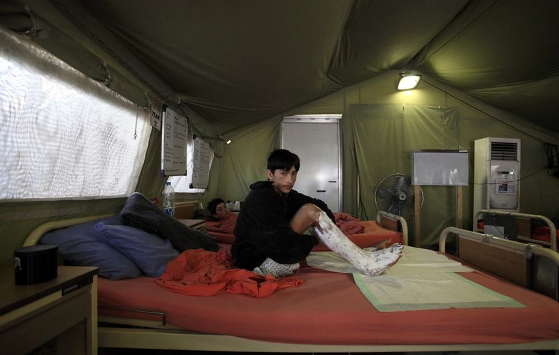 Scaling down operations in Pakistan, but staying - ICRC field hospital, Peshawar, 2011 - Photo courtesy of Reuters
