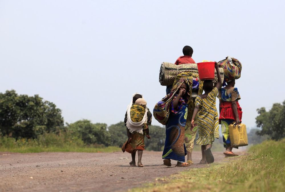 Violence and displacement on the rise in eastern DRC - A family walks towards Goma, July 23 - Photo courtesy of Reuters/James Akena