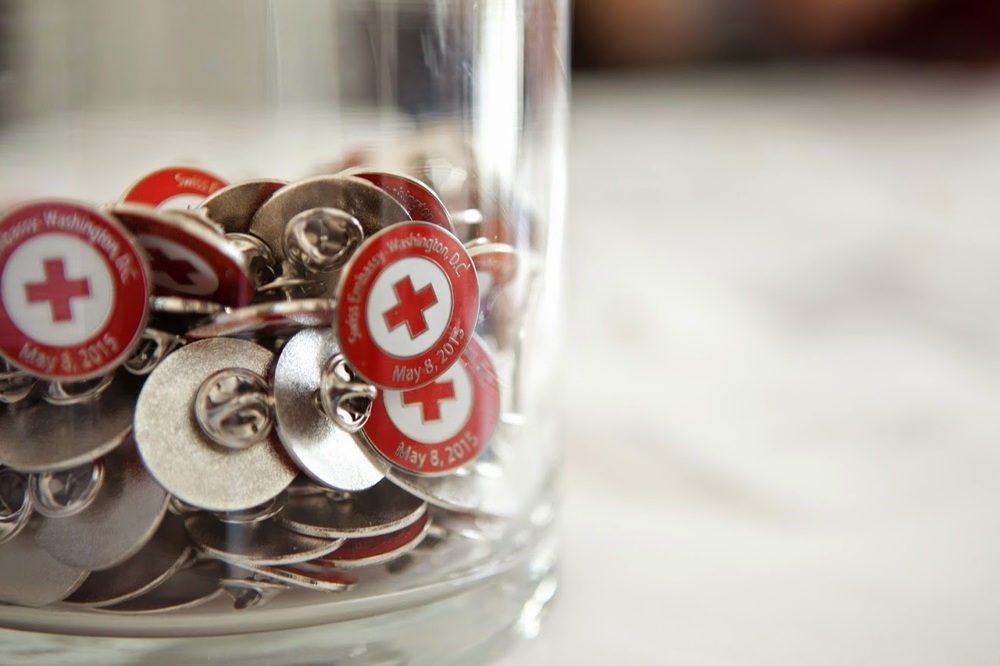 Bucket of ICRC pins on table