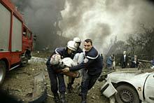 Algeria, 2007. Firemen evacuate a victim of a suicide car bomb. ©Reuters/L. Larbi