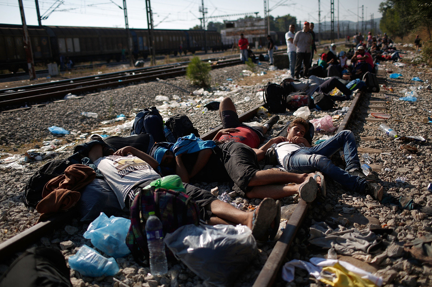 "Photo of the Week: FP published a gallery titled    ""by land or by sea""    capturing the journeys that REFUGEES are making to europe to escape their war-torn countries. In this shot, Syrian and Iraqi refugees sleep on railroad tracks in idomeni, Greece, while waiting to be processed across the macedonian border. © win mcnamee."