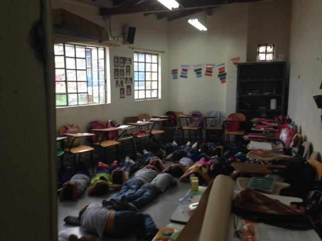 students and teachers practice drills during a gunfire simulation at their school in medellin.