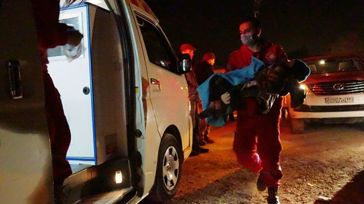 A severely ill child is evacuated by Syrian Arab Red Crescent during a joint aid operation with ICRC in Moademiyeh, Syria. Pawel Krzysiek/ICRC