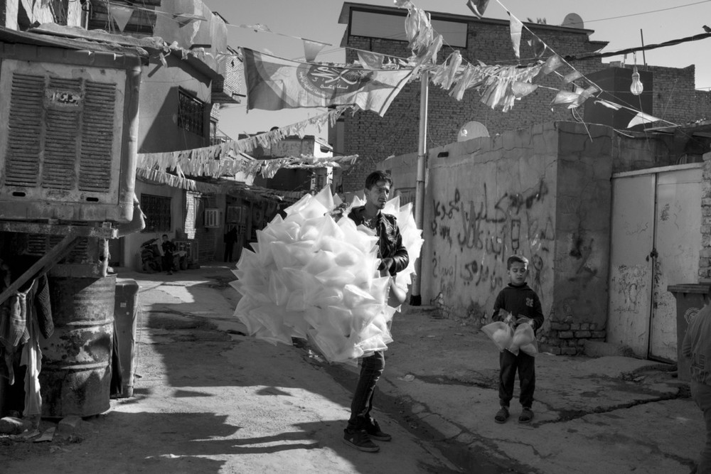 A man sells cotton candy in the district of Adamiyah, in central Baghdad. Adamiyah is a temporary home for hundreds of families that have fled violence. Moises Saman/Magnum Photos for ICRC