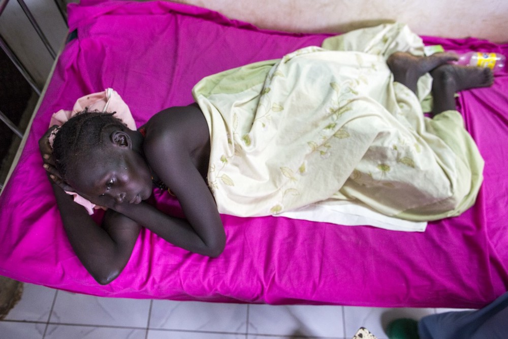 Nyaduel Gony rests after surgery. She lost her unborn baby after suffering a gunshot wound to the abdomen during an attack on her village.