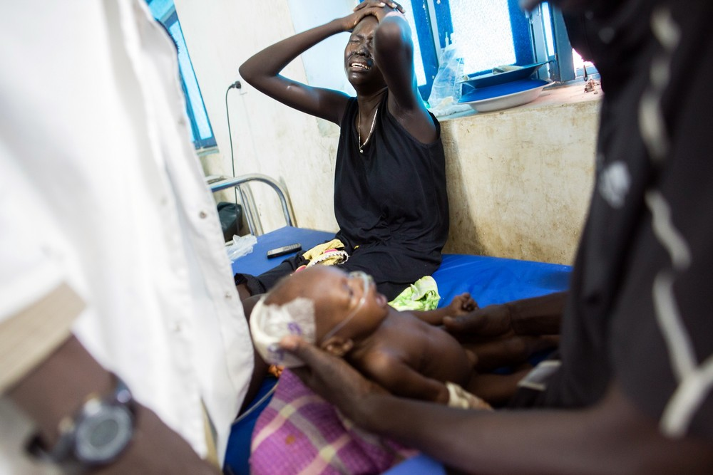 Nyamuoch weeps as she witnesses her daughter's struggle to hang on. She later passed away due to respiratory failure.