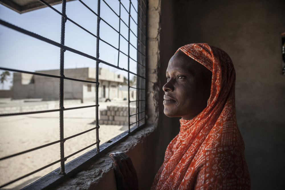 Ndiebène village, Senegal. Khady, 32 year old, the wife of a missing migrant, benefits from a psychosocial project led by the ICRC and Senegalese Red Cross Society. ICRC/Jose Cendon
