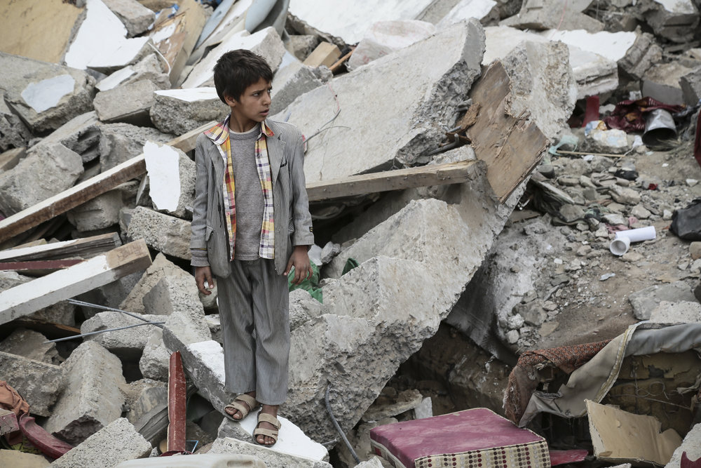 Sana'a, Yemen A boy among ruins caused by fighting. As the conflict has played out in Yemen, civilian infrastructure, including hospitals, airports, roads and residential areas have been damaged and at times deliberately targeted.