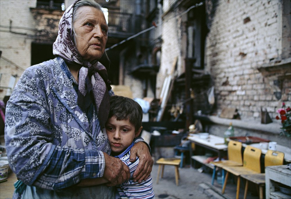 Grozny, Chechen Republic, Russia. A woman and child in part of the city destroyed by armed conflict.