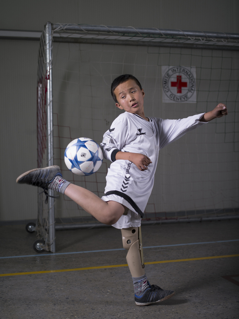 Kabul, Afghanistan/   Olivier Moeckli, ICRC   Sport has become one of the most visible aspects of ICRC's services for people with disabilities, combining physical rehabilitation, social reintegration, fun and entertainment. Here, a young boy plays indoor football.