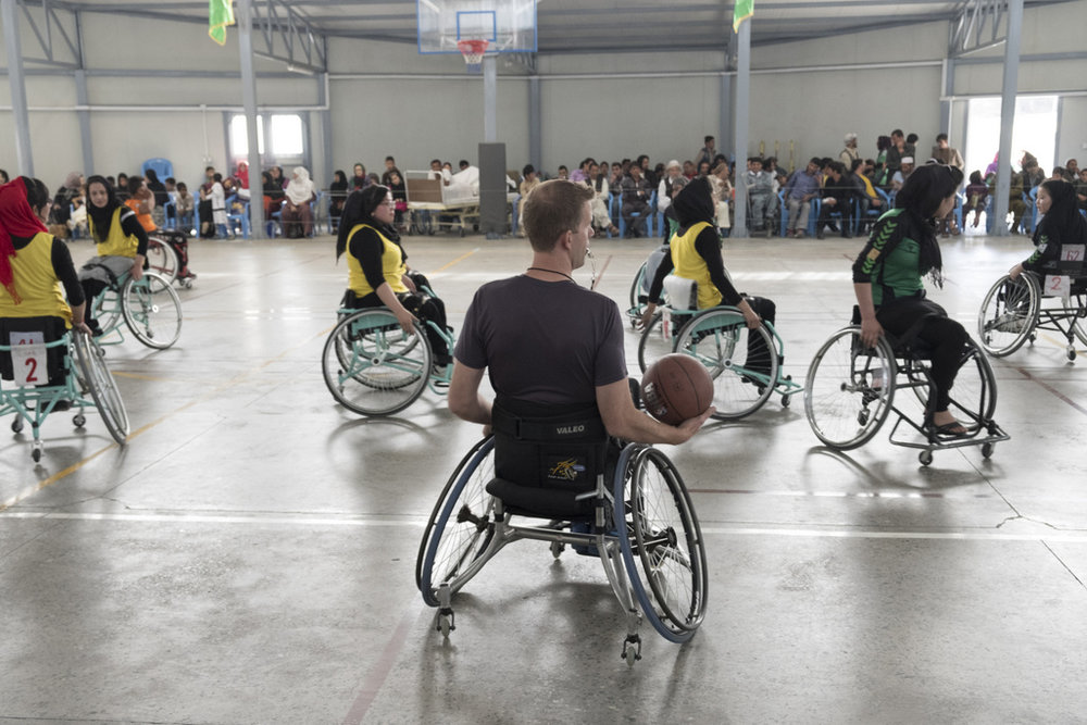 Kabul, Afghanistan/   Olivier Moeckli, ICRC   A few years ago, he teamed up with Jess Markt (pictured center), a basketball coach from Colorado, who is himself wheelchair-bound. Jess began playing wheelchair basketball after suffering a spinal cord injury at the age of 19. He has been coaching wheelchair basketball since 2009, and has also trained teams in India, South Sudan, the Palestinian Occupied Territories, and Cambodia.