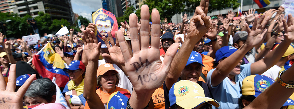 Opposition activists take part in a demonstration against President Nicolas Maduro in Caracas on July 9, 2017 (Juan Barreto/AFP/Getty Images)