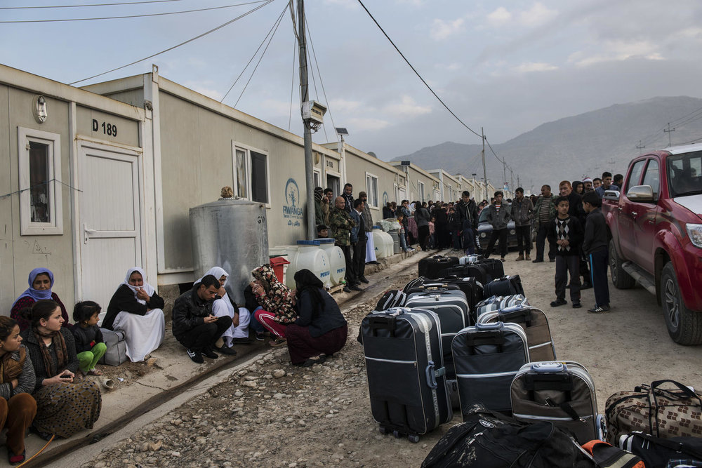 A camp for Yazidi refugees, some of whom were about to leave for resettlement in Germany, near Dohuk, Iraq, Jan. 2016. Some of the women had escaped sexual slavery at the hands of ISIS. Photo Courtesy of The New York Times/ Lynsey Addario