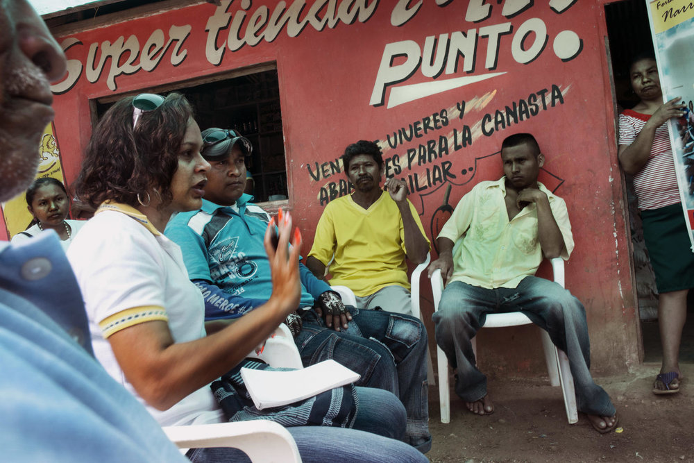 Mayerlis Angarita, an activist who visits remote villages encouraging people to make land claims, meets with people displaced by paramilitaries from their land in Sucre, Colombia, Nov. 2012. Photo Courtesy of the NYT/Stephen Ferry