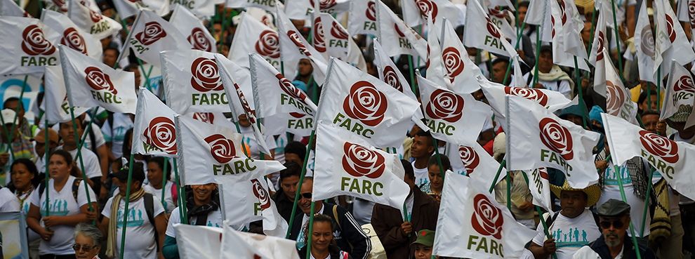 FARC members and supporters wave flags with the new logo of the rebaptized FARC following its disarmament, September 1, 2017 (RAUL ARBOLEDA/AFP/Getty Images)