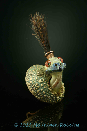 Pendant featuring glass emu with horse-hair mohawk emerging from bronze egg.