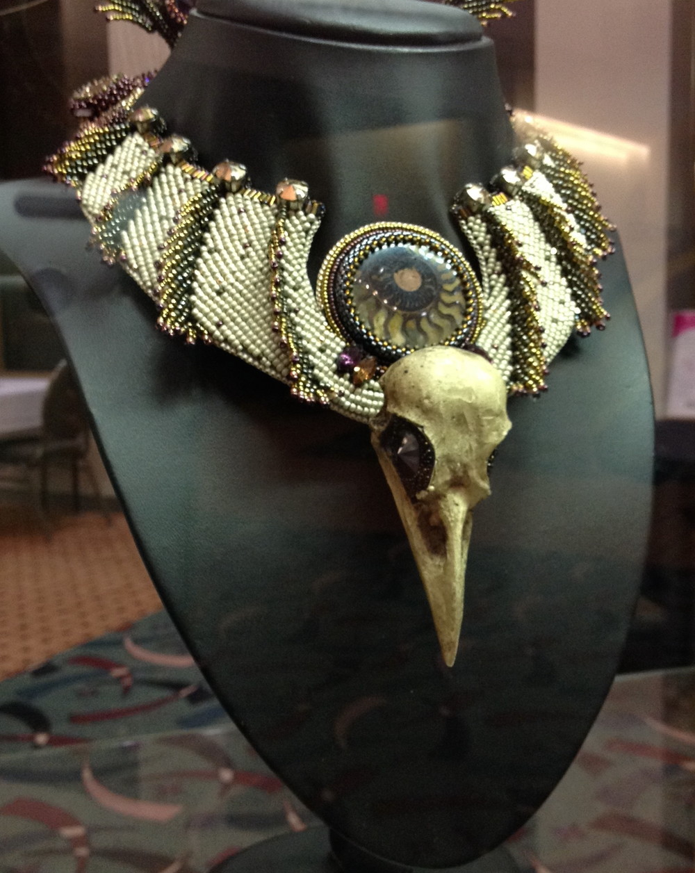 This is just a portion of the finished piece. It had very long feathers coming off the back of the necklace which extended up and over the top of the wearer's head by perhaps a foot or so. I think this was the year of the skulls.