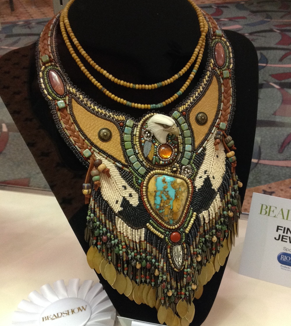 This piece was created by Sue Horine who is known for her large breast plate style necklaces. I believe the piece took a first place in it's category.