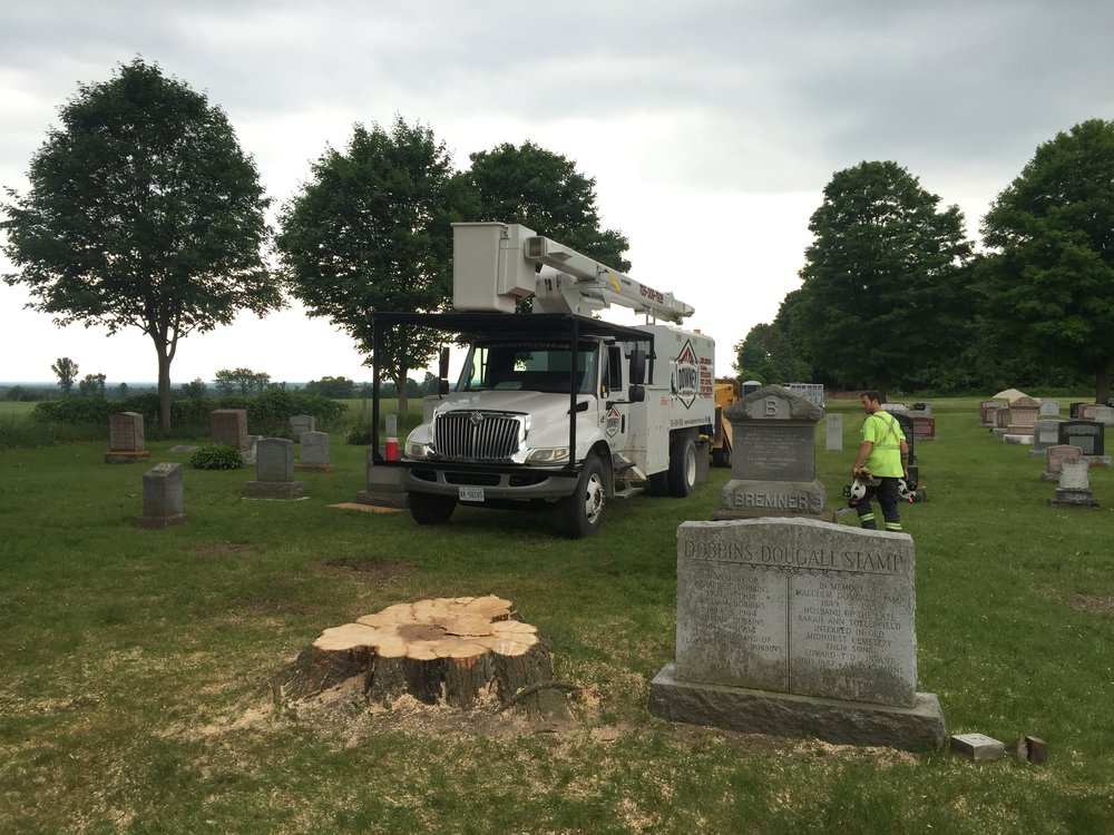 Post clean-up in the Minesing Union Cemetery.