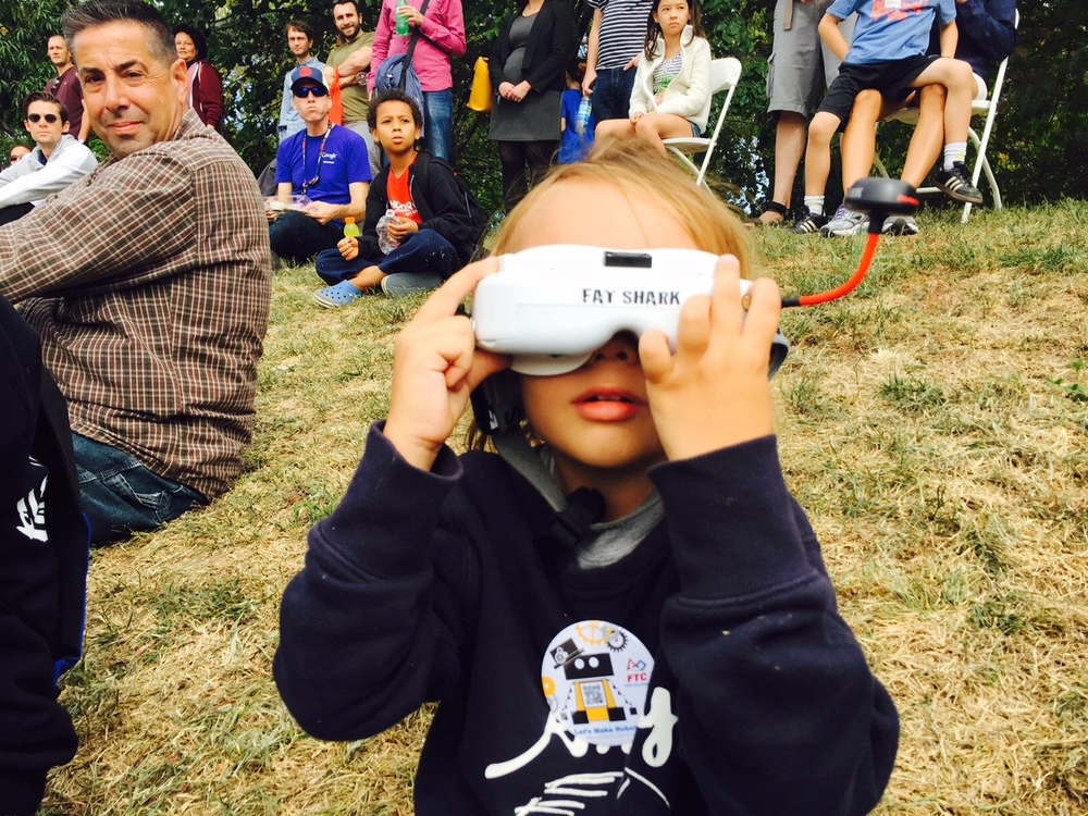 Young spectator checking out what FPV flying feels like at the NYC World Maker Faire earlier this year.