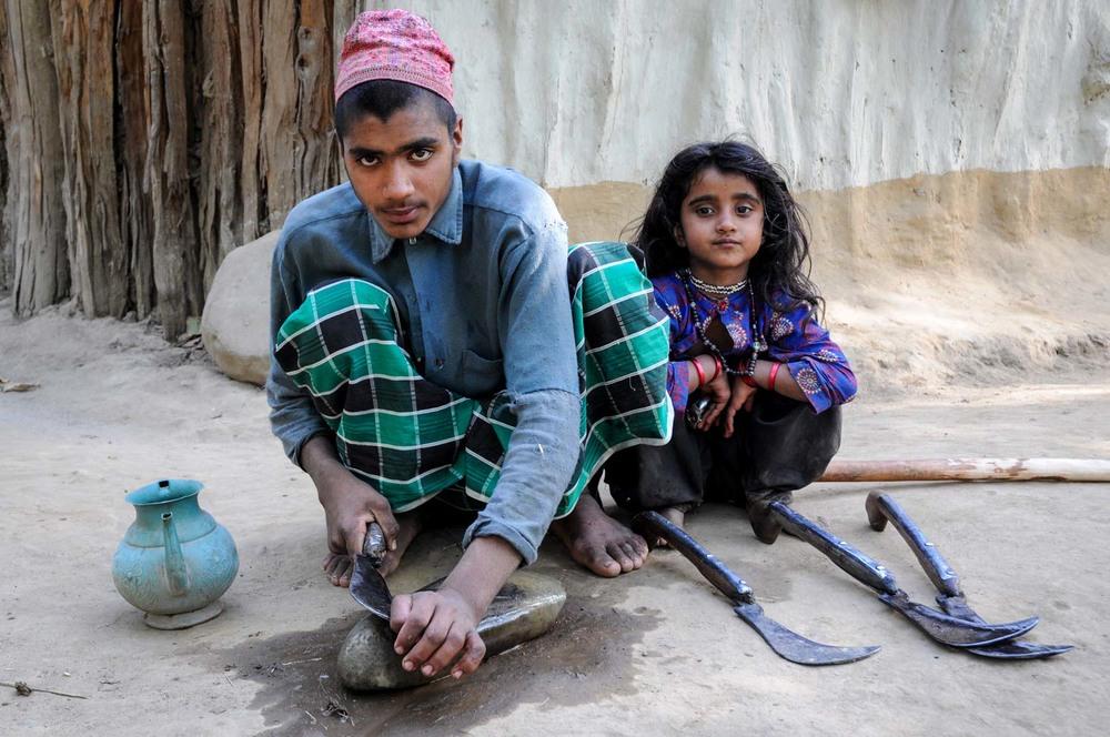 Mir Hamza, sharpening a patal, with Salma