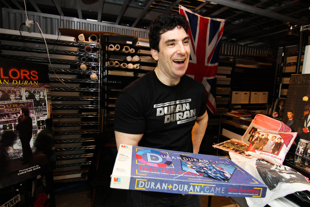 """Andrew """"Durandy"""" Golub, 42, shows off a Duran Duran board game called """"Into The Arena"""" from his Duran Duran collection on Saturday afternoon, April 5, 2014. Golub has become a well-known archivist of Duran Duran memorabilia. He houses his in a storage unit in Bellevue, Wash."""