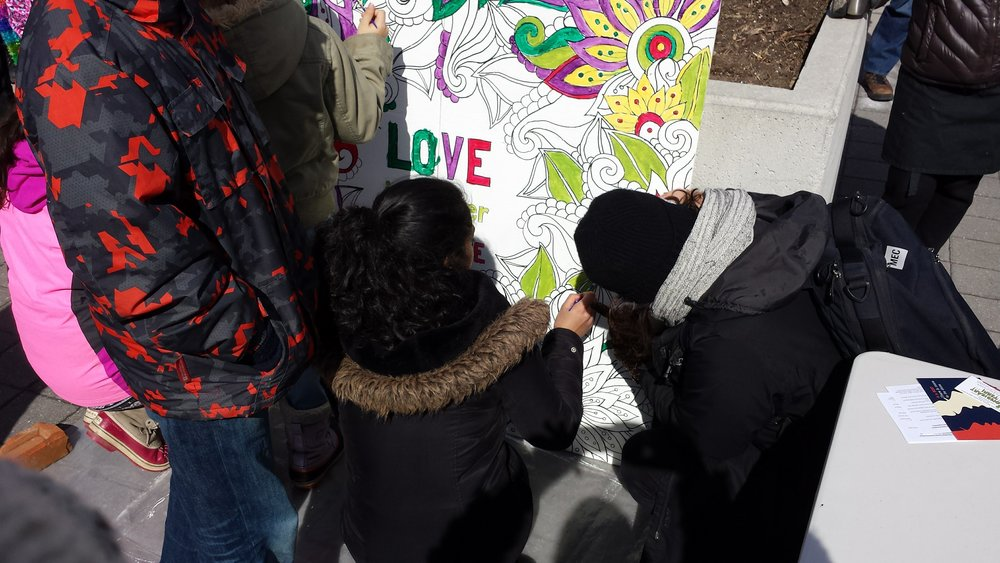 Contributing to the community art offering at the recent anti-Islamophobia march at City Hall