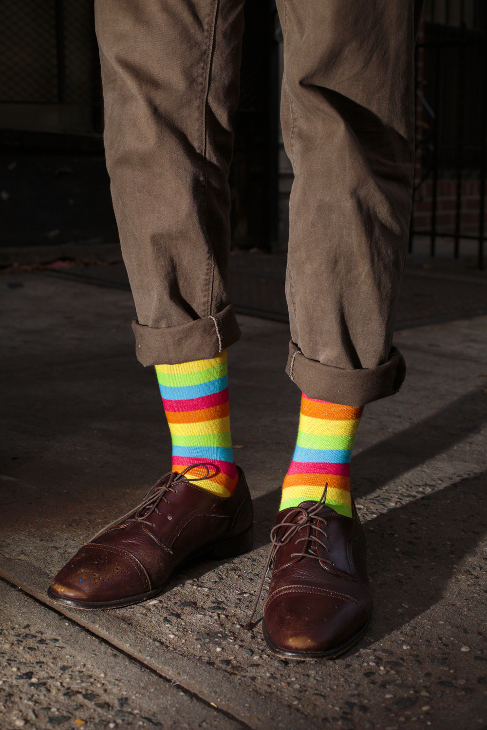 New York, USA - October 31, 2015: A passerby wears rainbow socks on 2nd St. The Bowery, a street and neighborhood in Manhattan, once home for vagrants and a diversity of subcultures became the playground of artists, fancy bars and real-estate tycoons.
