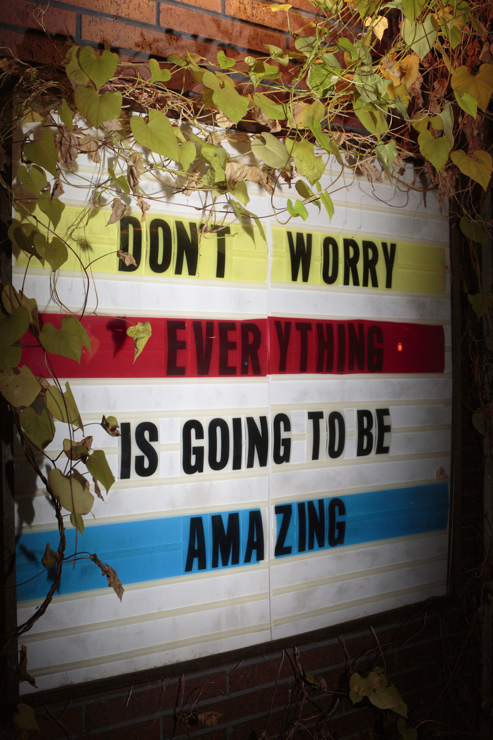 "New York, USA - October 31, 2015: ""Don't worry everything is going to be amazing"" is written on a sign outside the coffee shop Mudpark in the First Park on the corner of Houston St and 1st Ave. The Bowery, a street and neighborhood in Manhattan, once home for vagrants and a diversity of subcultures became the playground of artists, fancy bars and real-estate tycoons. 