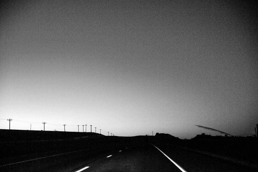 03 Jan 2016 - Amarillo, Texas - Die Route 287 Richtung Amarillo bei Sonnenuntergang. Amarillo ist eine der konservativsten und republikanisten Städte der USA und stimmte mit einer überragenden Mehrheit gegen Obama in den Präsidentschaftswahlen 2012. Photo Credit: Cédric von Niederhäusern
