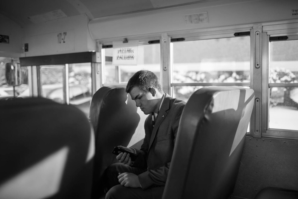 06 Feb 2016 - Manchester, New Hampshire - A young man is riding the media shuttle to the G.O.P. debate at St. Anselm's College.