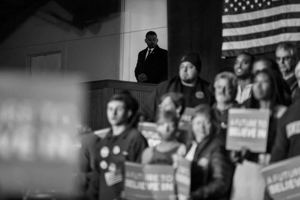08 Feb 2016 - Nashua, New Hampshire - A secret service agent is observing the crowd at a Bernie Sanders speech in the Daniel Webster Community College.