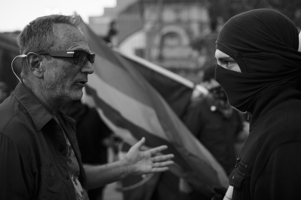19 July 2016 - Cleveland, Ohio - Two people with opposing political views talking back and forth on Public Square. The 2nd day of the Republican National Convention was still peaceful and quiet and now major incidents between Trump supporters and Anti-Trump protestors happened.