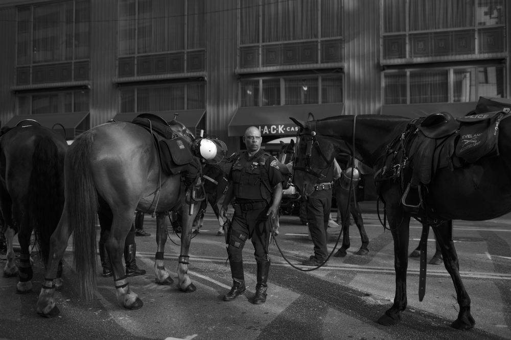 19 July 2016 - Cleveland, Ohio - An officer of the Cleveland Police Mounted Unit is taking a break after shift change on the 2nd day of the Republican National Convention.