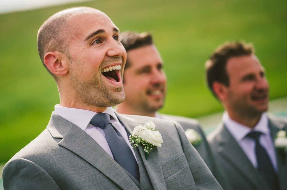 Groom reaction shot first look at bride