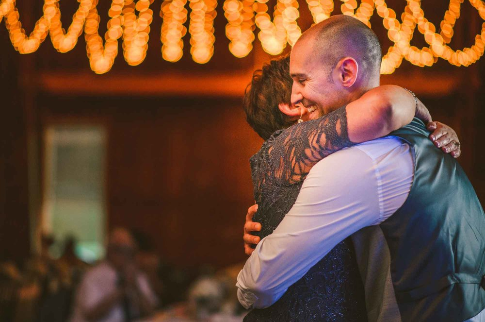 29-wedding-reception-mother-son-hug.jpg