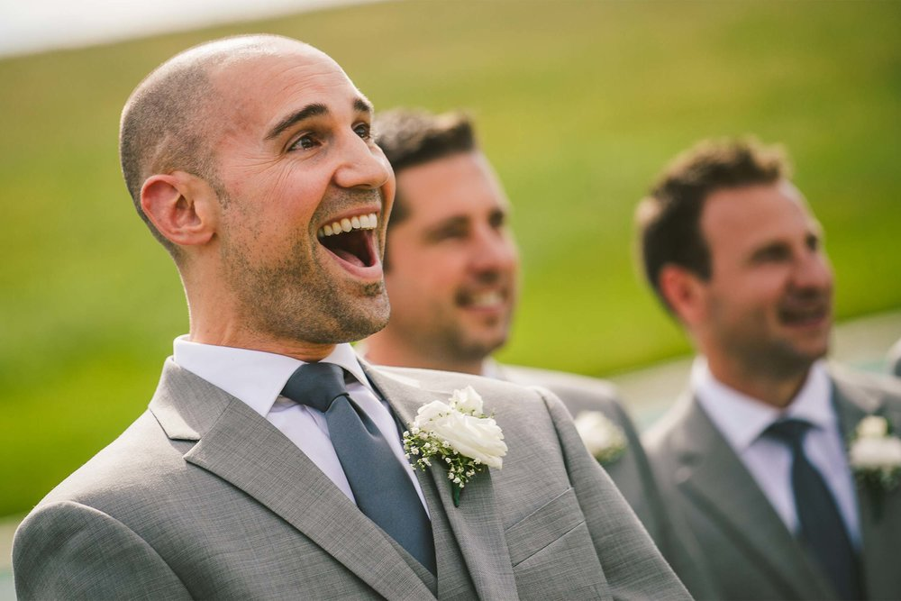 groom-surprised-first-look-wedding-ceremony.jpg