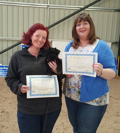 Two trainers who successfully complete the course.