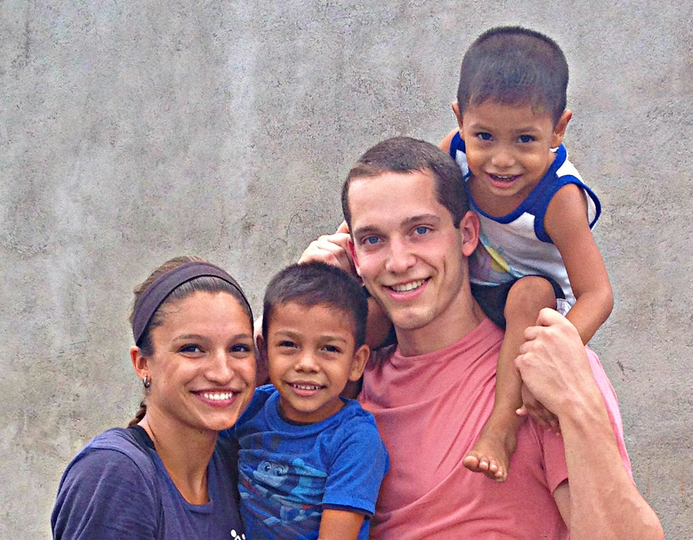 Families are reunited in Nicaragua! PD Dana and her brother, may summer intern, Connor play with brothers Jose Alejandro and Jose Santos.jpg